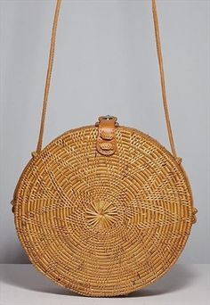 ROUND BASKET BAG WITH LEATHER CLIP