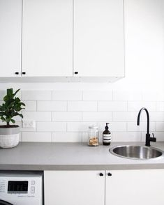 Versatile Concrete Benchtops – Giving Kitchen Trending Feature with Flexibility and Strength Grey Laundry Rooms, Laundry In Bathroom, Laundry Doors, Small Laundry, Kitchen Benches, Kitchen Decor, Caesarstone Raw Concrete, Grey Bathroom Tiles, White Cupboards