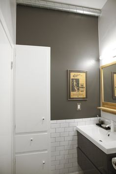 Amanda's Pink to Sleek Hall Bathroom Makeover — Makeovers: Renovation Project Colors by Sherwin Williams: Eider white walls and for the accent wall, a charcoal color I had custom made to match the grey Ikea vanity