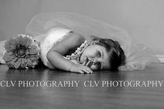 Little girl in moms wedding dress: Taken to display at her wedding someday! So cute! Taken by CLV Photography.  Website: www.clvphoto.com  Facebook: http://on.fb.me/19v1af5