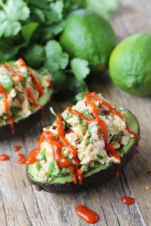 This Healthy Tuna Stuffed Avocado is stuffed with a flavorful southwest mixture. No mayo necessary here! It's the perfect healthy lunch.