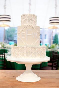 all-white monogram wedding cake.
