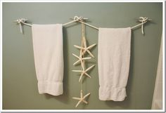 use boat cleats and nautical look rope for beach look towel rack