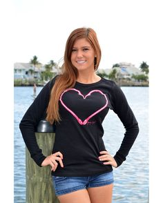 This Black thermal long sleeve is perfect for the cooler weather, featuring the pink heart hook with dazzling Swarovski Crystals withing the hook to show off you're fishing passion. Model wearing medium