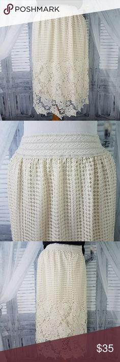 Ivory Lace Skirt Waist 30-40 Hip up to 42 Length 27 Mid-weight cotton/poly lace ivory color lined Below knee length Elastic waistband Machine wash Very good condition  2017272 J Gee Skirts