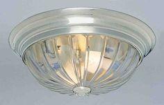 """View the Volume Lighting V7810 1 Light 11"""" Flush Mount Ceiling Fixture with Clear Melon Ribbed Glass Shade at LightingDirect.com."""