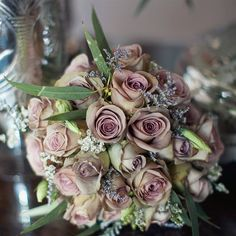 The bridal bouquet, which was mainly made up of different color Amnesia roses