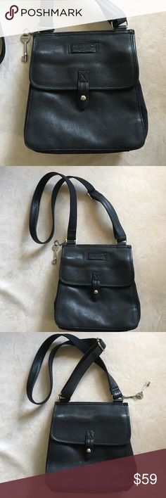 """Black Fossil crossbody bag. New condition. This bag has thick black leather and silver hardware. And, both sides have pockets with snap closures. It's like it has two fronts which is nice. Very clean. No flaws. The bottom and sides are a different texture. 9x8x3"""". Long adjustable strap. Fossil Bags Crossbody Bags"""