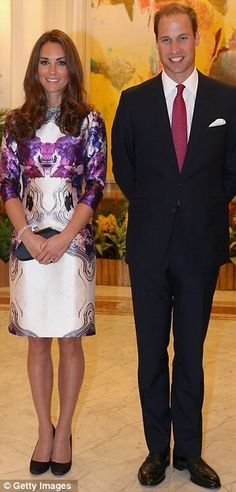 Duchess of Cambridge, right, attends the welcome ceremony for her husband, Prince William, the Duke of Cambridge, at the presidential palace in Singapore. The British royal couple started an official three-day trip to Singapore.  Stunning dress that has the right 'in country' look. Purple and white floral patterned dress was designed by Singapore-born Prabal Gurung. Stepping out in the vibrant dress, which she teamed up with black heels and a black clutch bag. 9-11-12