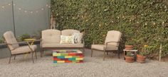 Spray paint some bricks and stack them lego-style. Of course make sure you have gravel, sand, or some other inflammable base — you want to spruce up your backyard, not burn it down. Get the full instructions here.