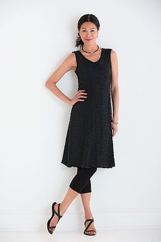 With its Italian sculpted fabric, this flared dress adds new dimension to the concept of a little black dress. Fiore Flared Tank Dress by Carol Turner: Knit Dress available in more colors at www.artfulhome.com