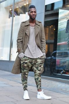 Men's camo dropcrotch pants. White sneakers. Dark green trench. https://www.lookli.st