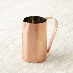 An adorbable and hipster-chic copper pitcher from #westelm, perfect for casual meals and serving.