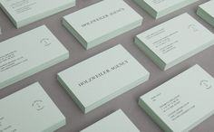 Logo and coloured board business card designed by Bielke+Yang for Oslo based, family run contemporary fashion distributor Holzweiler