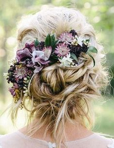 Perfectly Imperfect Updos You'll Love for Your Wedding: Put flowers in your hair that match the in-season flowers for your wedding for a look that will stun everyone!
