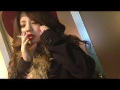 Who is this beautiful smoking Japanese girl?