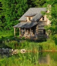 I want a cabin on a private setting with a pond just like this