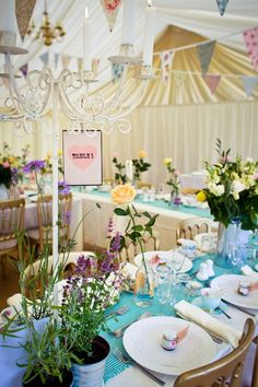 Fun and quirky, love the use of colours, decorations, flowers, table runners..