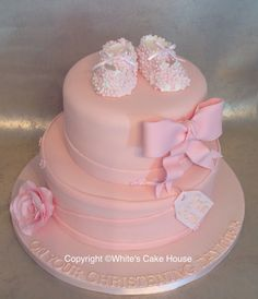 Shoes and bow christening cake.