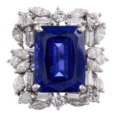 13.51 CT Tanzanite Baguette and Round Diamond Cluster Ring | From a unique collection of vintage cocktail rings at https://www.1stdibs.com/jewelry/rings/cocktail-rings/