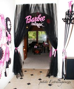 I recreated this and loved it ! I got my fans from oriental trading , and then got die cuts off of etsy - I got a large barbie die cut like the one shown - super cute entrance for the girls! Chandliers in metallic pink or black from Michaels craft store