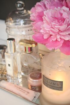beautiful flower, cosmetics and candle for my mood