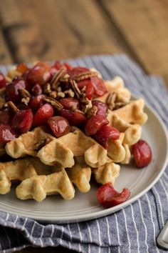 The perfect breakfast for summer: these whole wheat/oat waffles are topped with an easy freshly cooked vanilla bean cherries. @NaturallyElla
