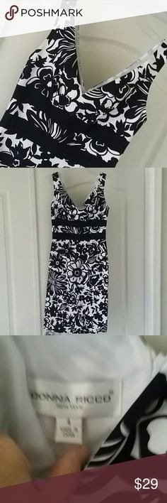 "NWOT BLACK AND WHITE FLORAL DRESS NWOT double vneck dress 2 black bands strings empire waist 15"" armpit to armpit and 39"" from top of shoulder to bottom of dress Zipper up back No rips or stains 97% cotton, 3% spandex. Lining is 100% polyester Smoke free home Donna Ricco Dresses"