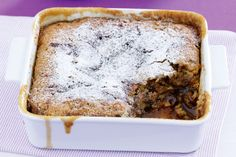 Sticky date self-saucing pudding - Ingredients   1 1/4 cups self-raising flour  2/3 cup firmly packed brown sugar  40g butter, melted  2/3 cup milk  1 cup pitted dried dates, finely chopped  1/2 teaspoon ground cinnamon  Icing sugar and custard, to serve