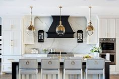 Black and white island with gray barstools