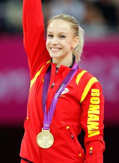 Gymnast Sandra Izbasa of Romania, wins gold in the vault and lights up London with her beautiful smile.