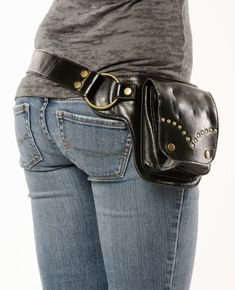 This beautiful black leather and antique brass hardware utility belt is edgy and goes great with every style. The soft leather conforms to your waist. The adjustable straps ensure a perfect fit for any size. This utility belt is handmade with the best quality on the market. This holster