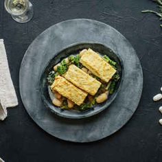 Parmesan-Crusted Tofu with Gigante Beans and Broccoli Rabe