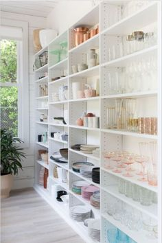 Learn how we achieved pantry perfection for the team at Camille Styles with an open and thoughtful storage concept that beautifully keeps everything in its place. #CaliforniaClosets #pantry #custom #designinspo