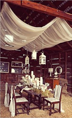 We could do this ceiling curtain trick in our living room! We could get two tension rods and put flowy fabric on it!!!