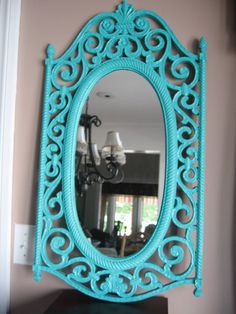 1960s vintage scroll mirror; painted a bright color for POP on beige living room wall