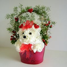 moss covered containers for flower arrangements  | If it's only puppy love or if she just loves puppies this cute little ...