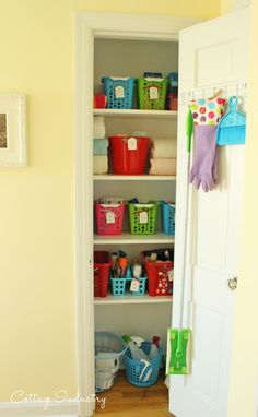 Dollar Store Linen Closet Makeover ~ use of fun colored bins & baskets