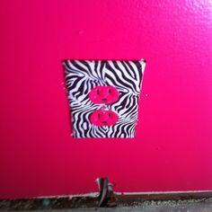 ICovered a outlet plate with zebra duck tape in my daughters room we went with a lime green hot pink and zebra striped theme.