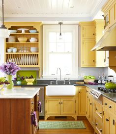 yellow kitchen cabinets - Talk of the House Makes for a modern look with the grey counters