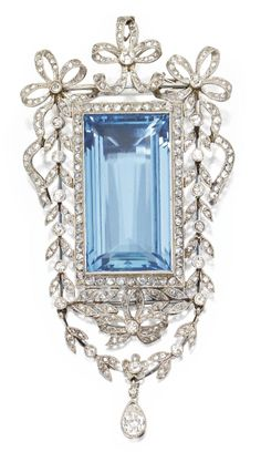 Platinum, Aquamarine and Diamond Pendant-Brooch, Circa 1910. Set in the centre with an emerald-cut aquamarine weighing approximately 33.15 carats, within a frame of stylised bows and foliate design set with pear-shaped, old European-cut and rose-cut diamonds weighing a total of approximately 2.75 carats. #BelleEpoque #Edwardian #pendant #brooch