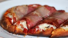 Christopher's On Congress uses naan as the base for this mozzarella and cured meat pizza. #SanDiego