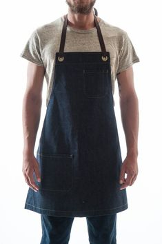 The Reggie Bib Apron is our classic bib style. Full coverage, with adjustable straps tied at neck and waist. Jean Apron, Custom Aprons, Bib Apron, Apron Diy, Aprons For Men, Patchwork Jeans, Denim Crafts, Sewing Aprons, Recycle Jeans