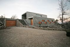 House in Serra de Freita / Oficina d'Arquitectura.  Ooohhh...  I really like this on many levels.
