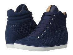 This Coach wedge sneakers match perfectly with skinny jeans. Super cute way to complete your casual look!