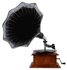 Antique Gramophone   I have one of these, but mine has had more wear and tear.  Also, it plays cylinders, not platters.  It's really cool!