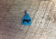 Small blue sparkly ear tag pendant with black pig silhouette. Comes with rhinestone pinch bail. Repin to be entered to win one of four $50 gift certificates during our Five Year Anniversary Celebration in July 2014.