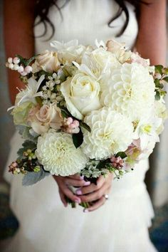 {Gorgeous Bridal Bouquet: Ivory Dahlias, Roses, Cream Roses, White Narcissus, White/Pink/Green Snowberry, White Persian Star Flower, Dusty Miller, Green Foliage}