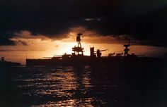 80-G-K-387 (Color): USS Texas (BB-35). Silhouetted against the sunset, while participating in North Atlantic convoy operations, circa summer 1941. Photographed by Lieutenant Dayton A. Seiler, USN. Official U.S. Navy Photograph, now in the collections of the National Archives.