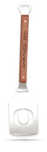 Sportula Products 7010335 Oregon Ducks  Sportula by SPORTULA PRODUCTS. $24.99. Hard maple handles with durable brass rivets. Heavy-duty stainless steel. convenient bottle opener. Custom heat-stampled lettering. Unique laser-cut design. The Sportula is a heavy duty stainless steel grilling spatula that is perfectly designed for the Ultimate Tailgater.